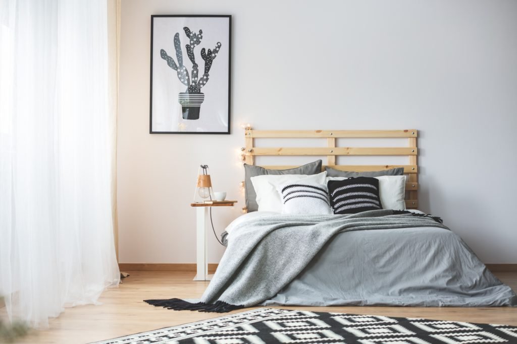 Charming Bedroom Corner with Large Window and Cactus Wall Poster