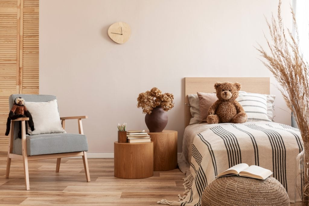 Child's Brown Room with Striped Bedding and Teddy Bear