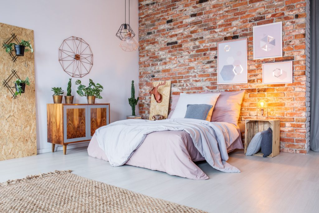 Colorful Bedroom with Rustic Brick Wall and Cactus Plants
