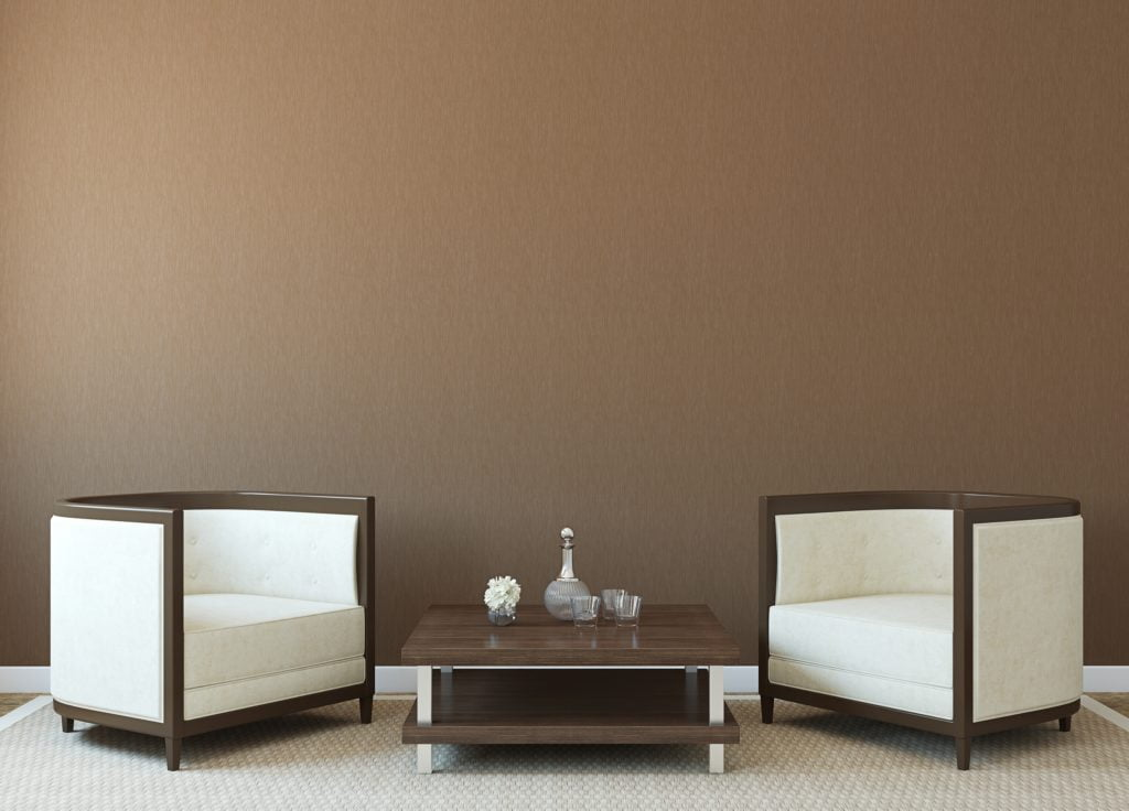 Deep Brown Wall with Elegant White Modern Armchairs and Accents