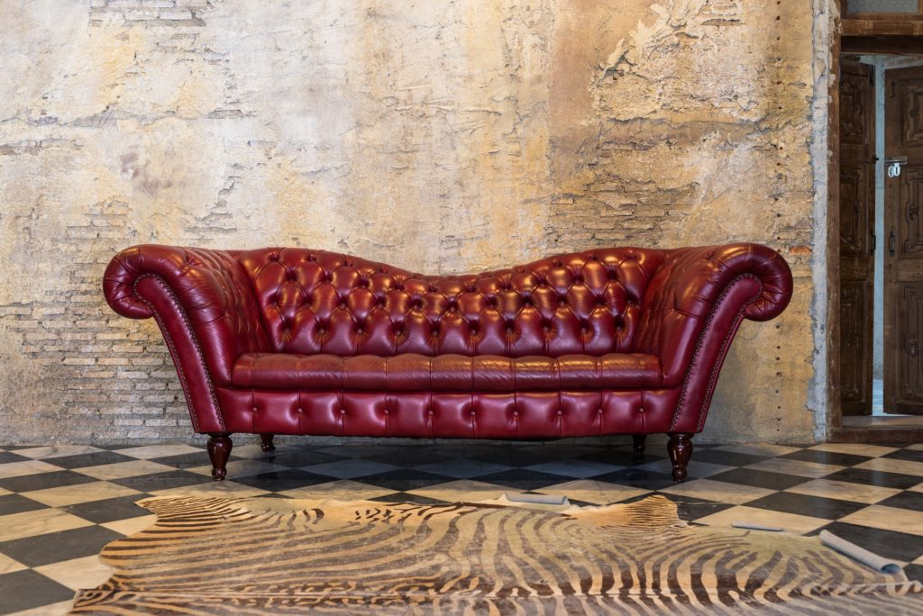 Deep Red Vintage Couch with Wave Back Style and Curled Arms