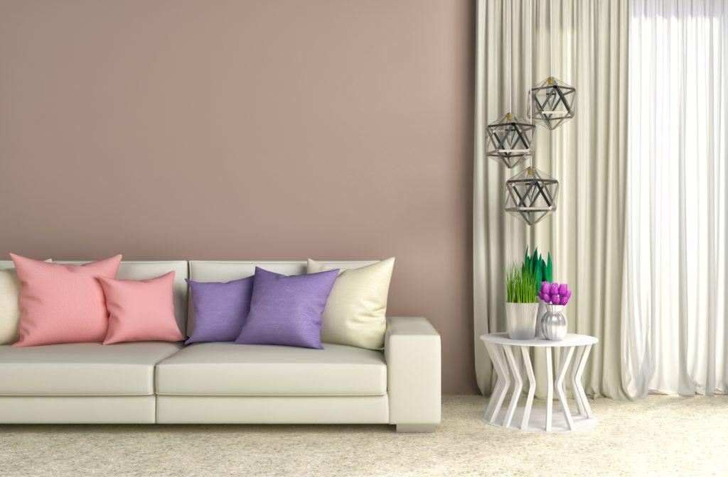 Fashionable Brown Wall Living Room with White Sofa and Beautiful Silk Pillows