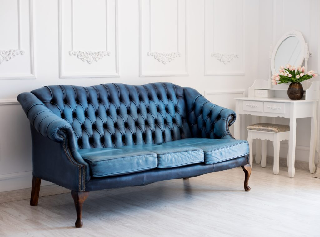 Opulent Blue Leather Sofa from Elegant Past Eras