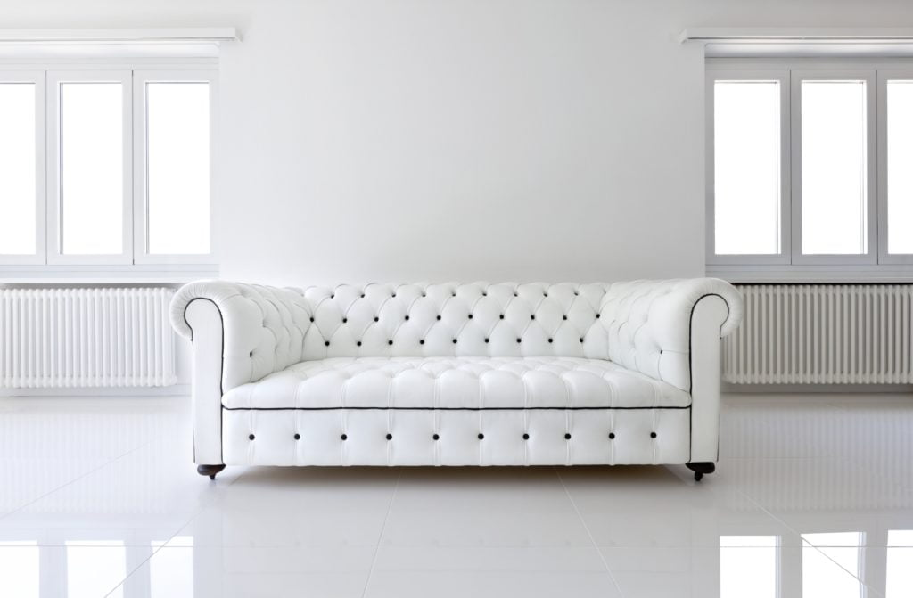 Sophisticated White Leather Sofa in Sleek, Sculpted Style