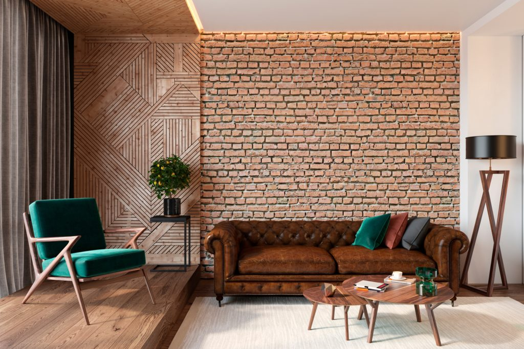 Stylish Brick Wall with Luxurious Brown Chesterfield Sofa
