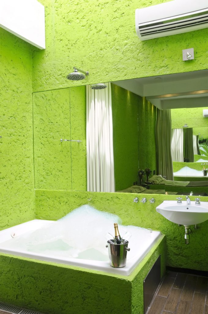 Bright Green Bathroom with Jacuzzi