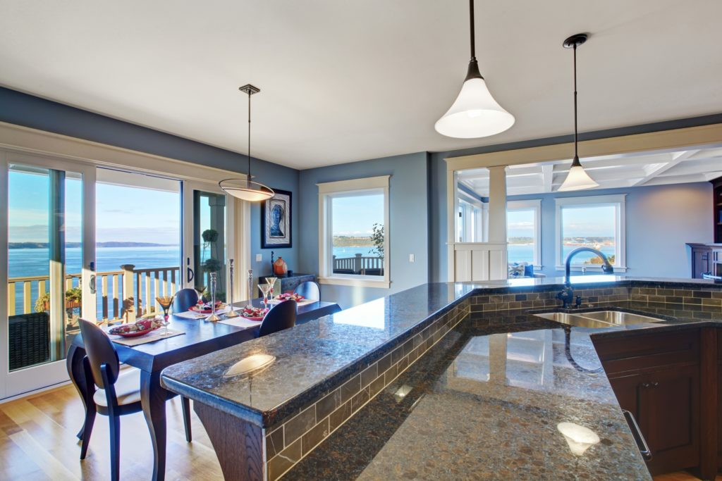 Large Modern Kitchen in Blue and Brown with Seaside View