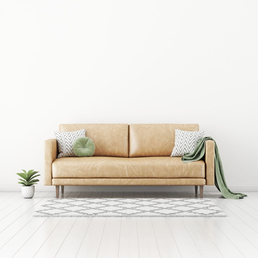 Beige Leather Couch with Decorative Pillows in Neutral Room