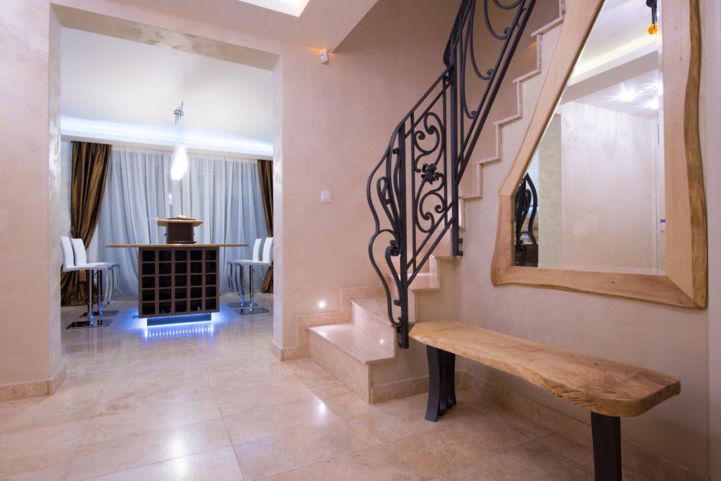 Beige Mansion Foyer with Bench