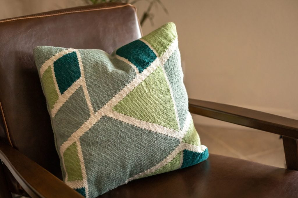 Bring a Touch of Nature Indoors with These Refreshing Green Geometric-Patterned Pillows That Transforms an Ordinary Brown Couch & Chair Into Extraordinary