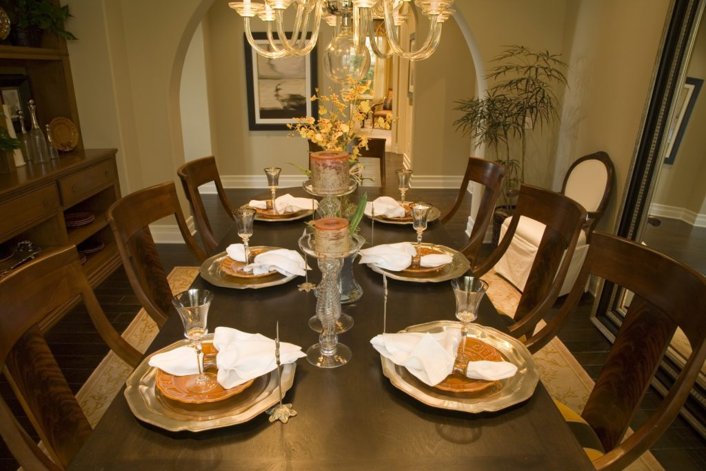 Brown Dining Room with Chandelier