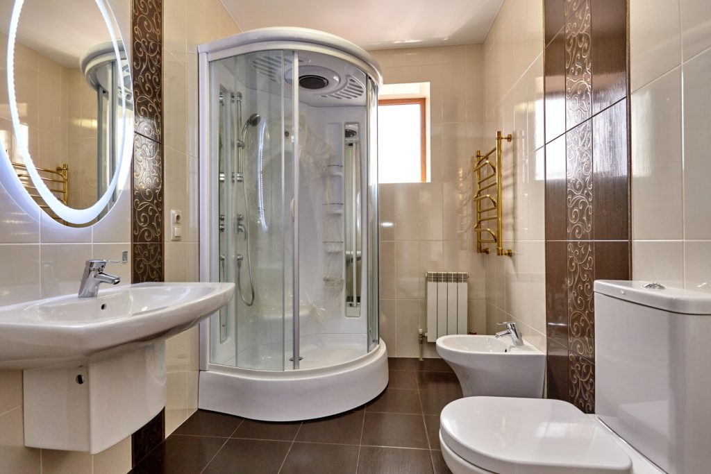 Brown Mansion Bathroom with Oval Mirror