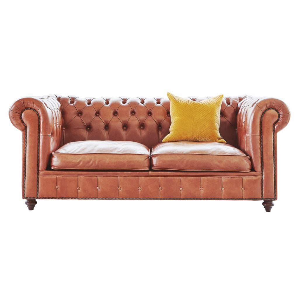 Cheerful Yellow Scatter Pillow Looks Stunning Next to a Caramel Brown Tufted Upholstered Couch