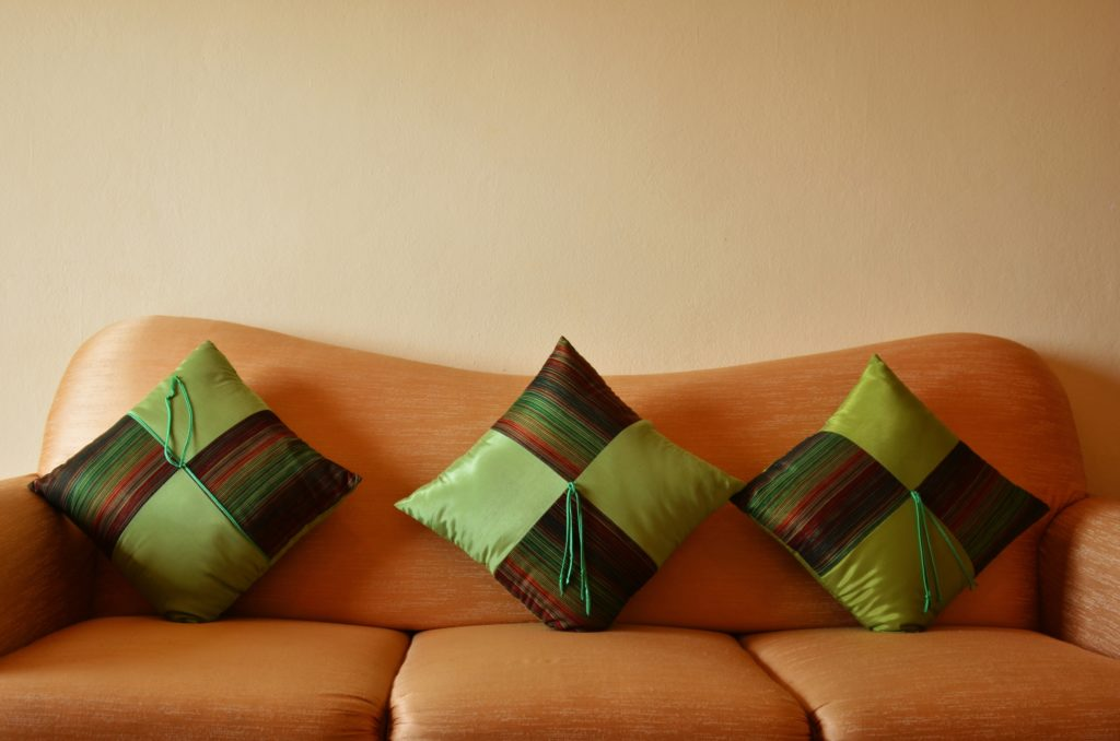Colorful Apple-Green Pillows with Coordinating Striped Squares Melded with Solid Green Look Fresh & New Next to a Buttery Tan Brown Sofa