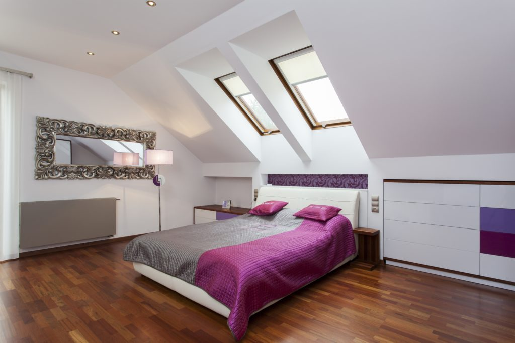 Contemporary Attic Bedroom in a Stylish Mansion Setting