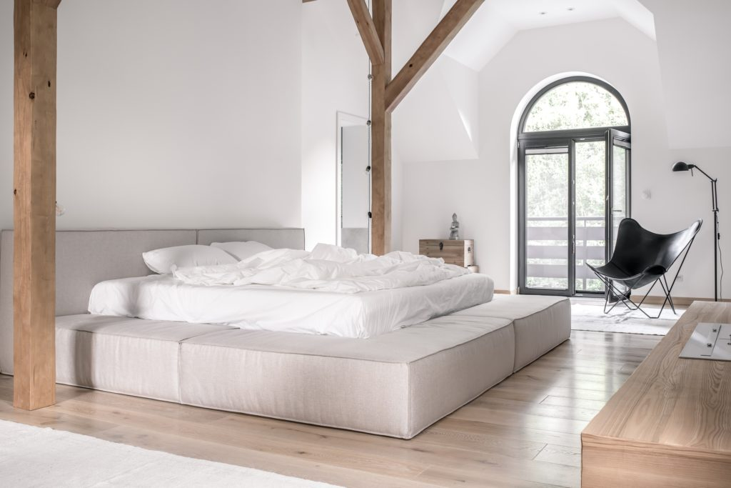Contemporary Mansion Bedroom with Vaulted Ceiling and Wood Beams