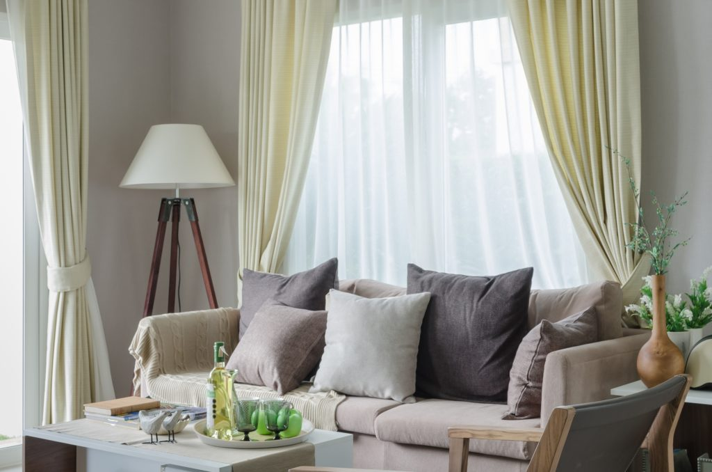 Country Cottage Living Room with Beige Couch and Large Throw Pillows