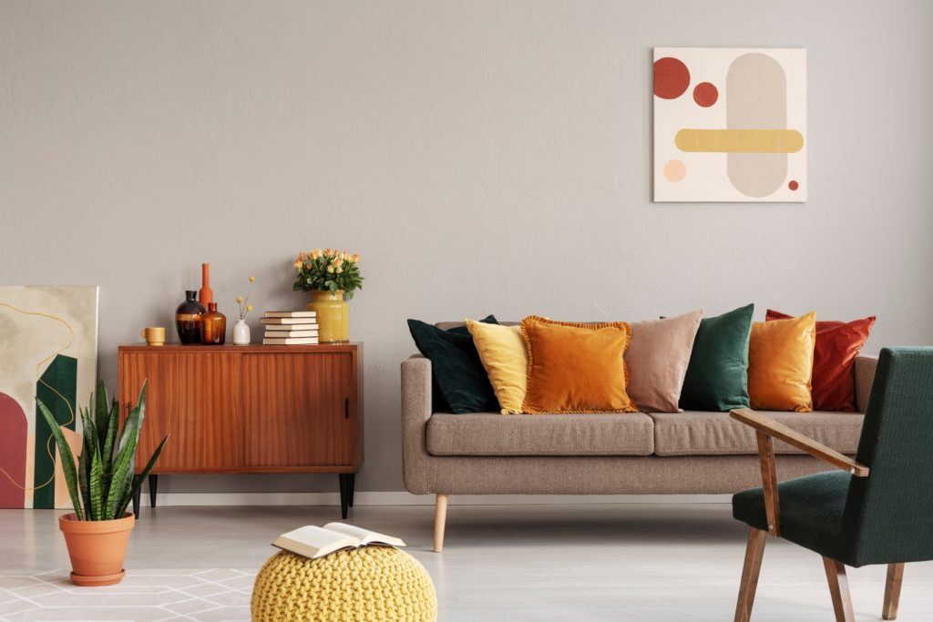 Creative Modern Living Room with Beige Couch and Vivid Pillow Colors