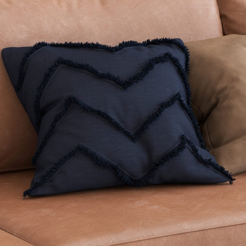 Deep Blue Pillow with Texture Trim Showcases an Amber Toned Couch in a Modern Design