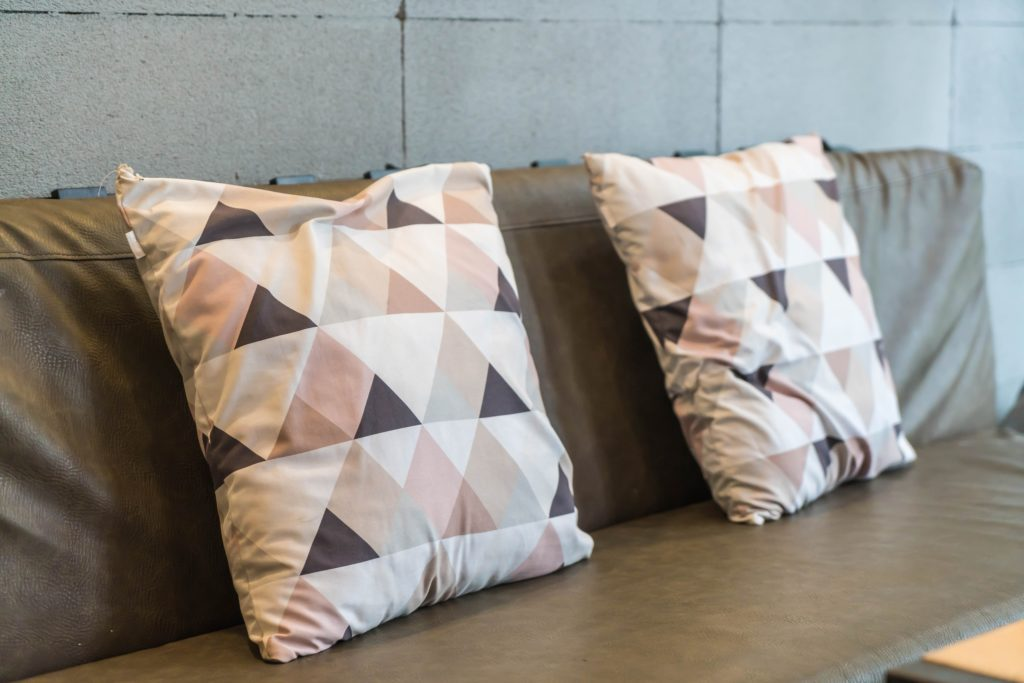Easy Comfort Accent Pillows Soften Up a Couch Back in a Homespun Pyramid Quilted Pattern of Tan White Pale Pink Hues