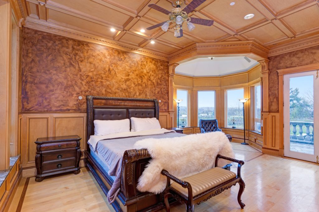 Elegant Mansion Bedroom with Wood Coffered Ceiling and Beautiful Reading Nook