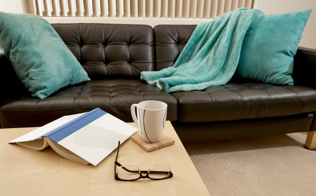 Gorgeous Velvet Pillows & Blanket Throw in Icy Aqua Shade Wakes Up a Tired Design Instantly