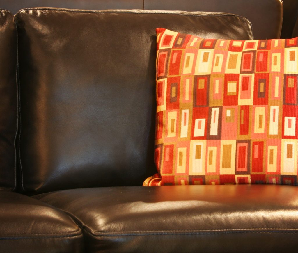 Large Couch Pillow Featuring Bold Western Style Pattern in Orange Bronze Golden Amber Hues