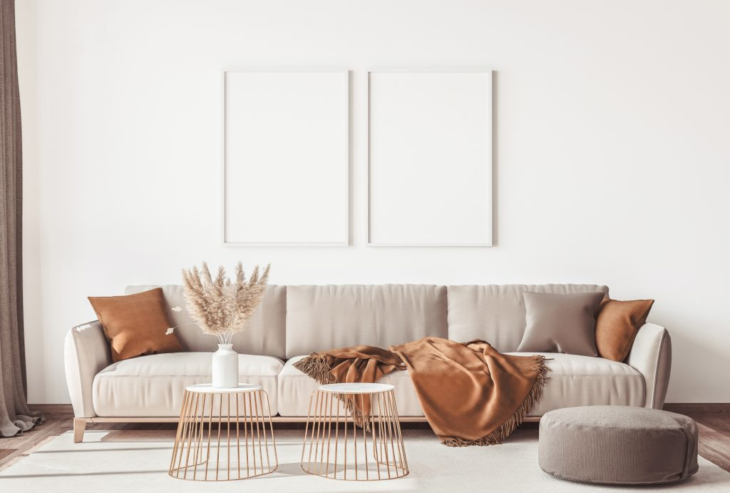 Long Beige Couch with Rich Cocoa Orange and Beige Pillows