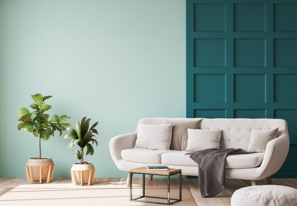 Modern Beige Couch and Pillows in a Green Walled Interior