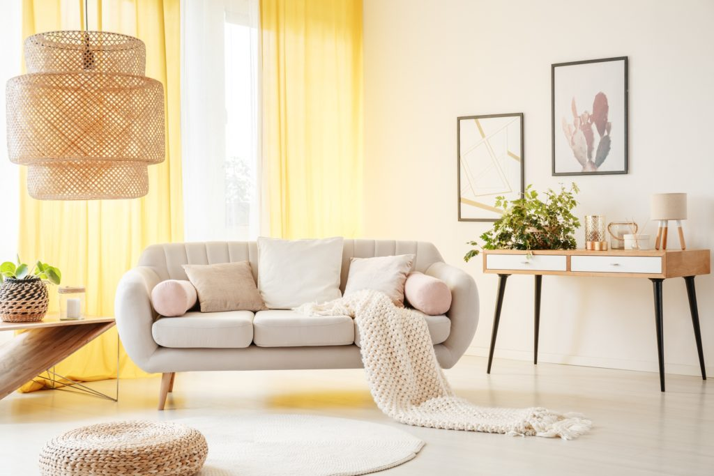 Modern Beige Couch in Sunbathed Room with Light Gold Drapes