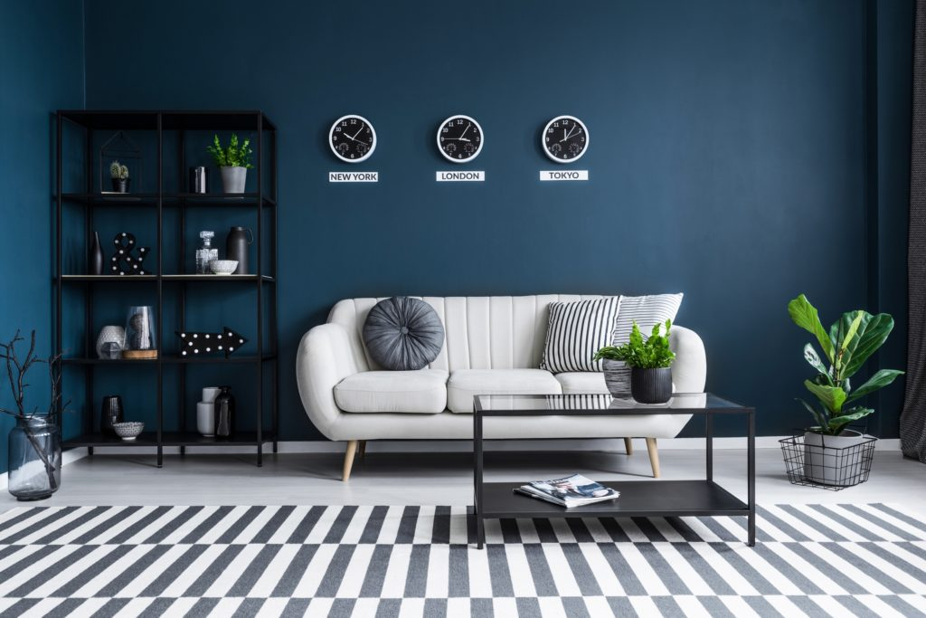 Navy Blue Living Room with Beige Couch and Throw Pillow Accents