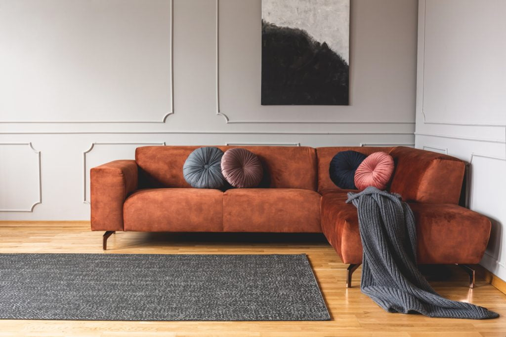 Round Grey Pink Beige Black Velvet Pillows Spice-Up a Ginger Brown Couch Deliciously
