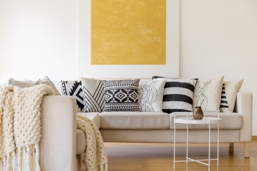 Scandinavian Living Room with Beige Couch and Patterned Pillows