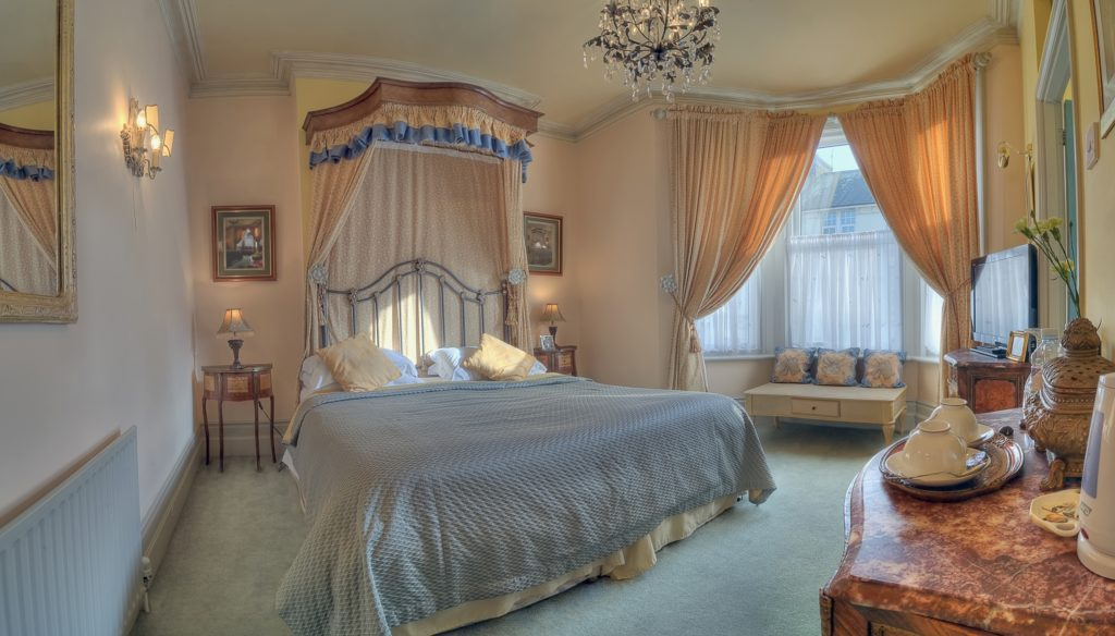 Shabby Chic Mansion Size Bedroom with Charming Bay Window