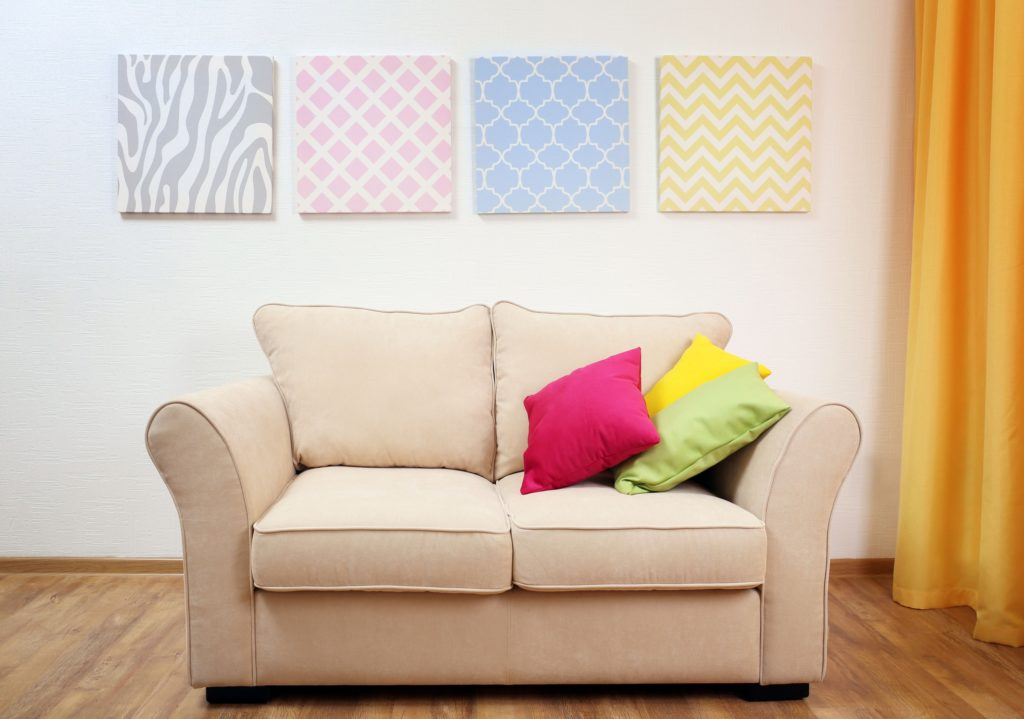 Small Beige Couch in Colorful Boho Style Living Room