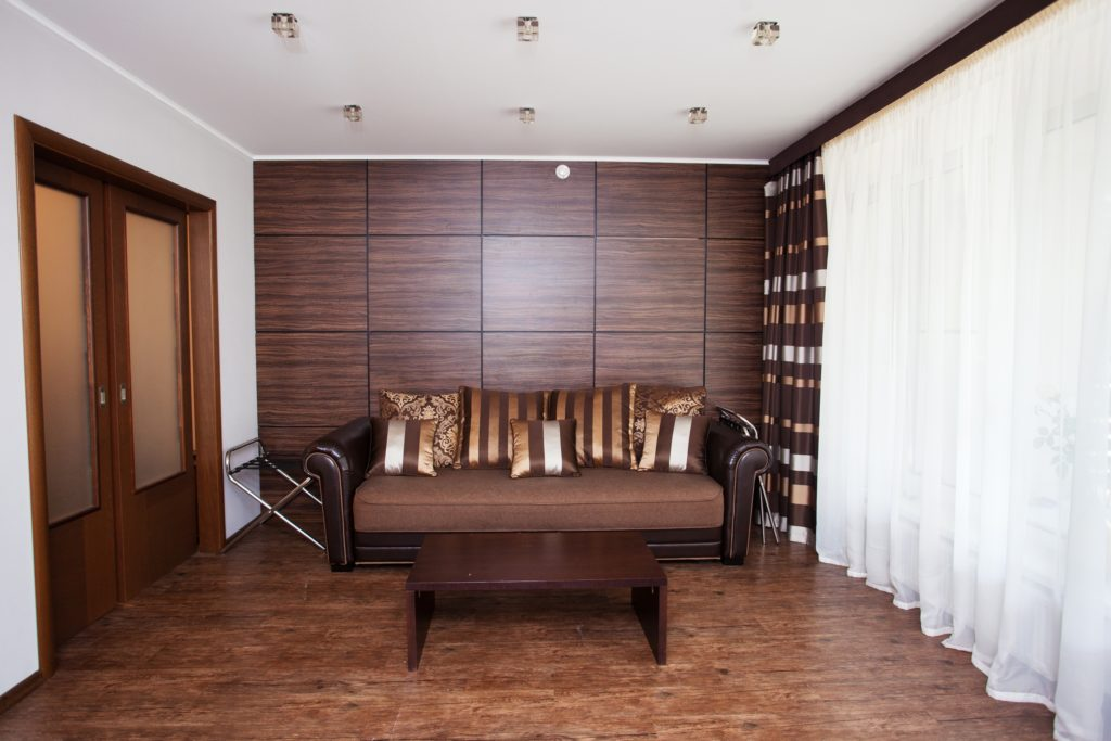 Striped Luxurious Pillows in Brown Tones Create a Welcoming Place to Sit