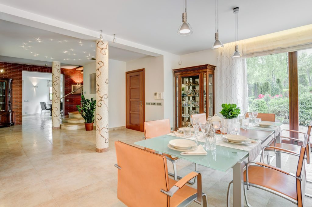 Tan and Glass Dining Room
