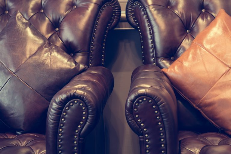Timeless Leather Retro Styled Rich Walnut Color Sofa Large Square Butterscotch Walnut Hued Pillows
