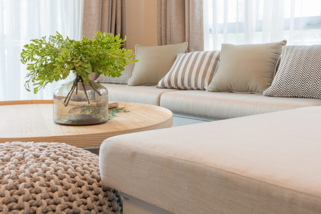 Beige Curtains with Wooden Round Table