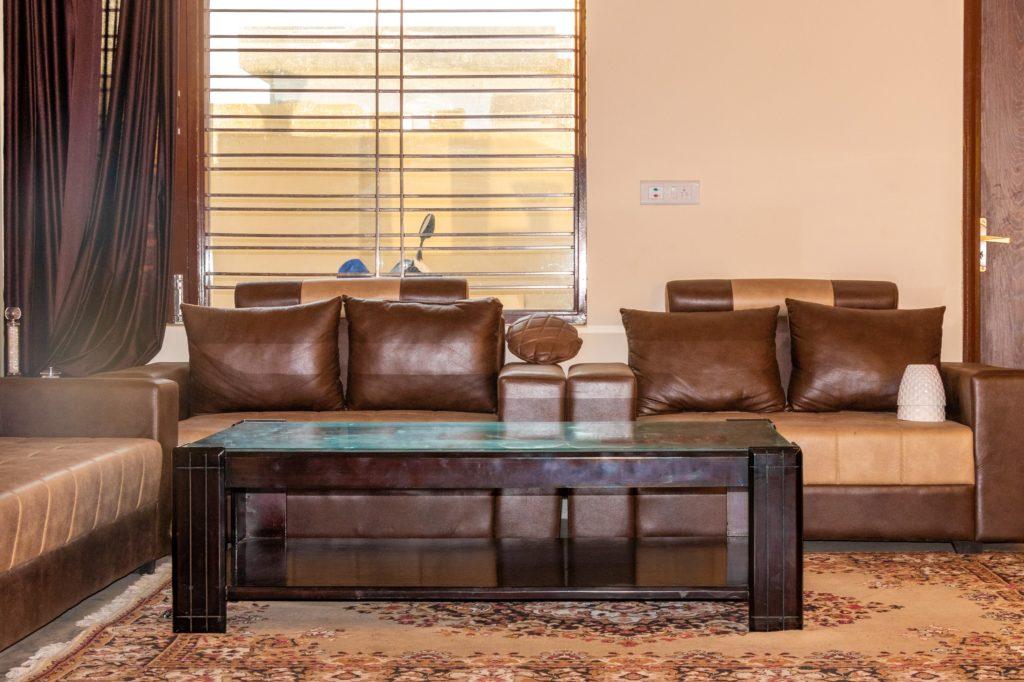 Brown Curtains with Wooden Coffee Table