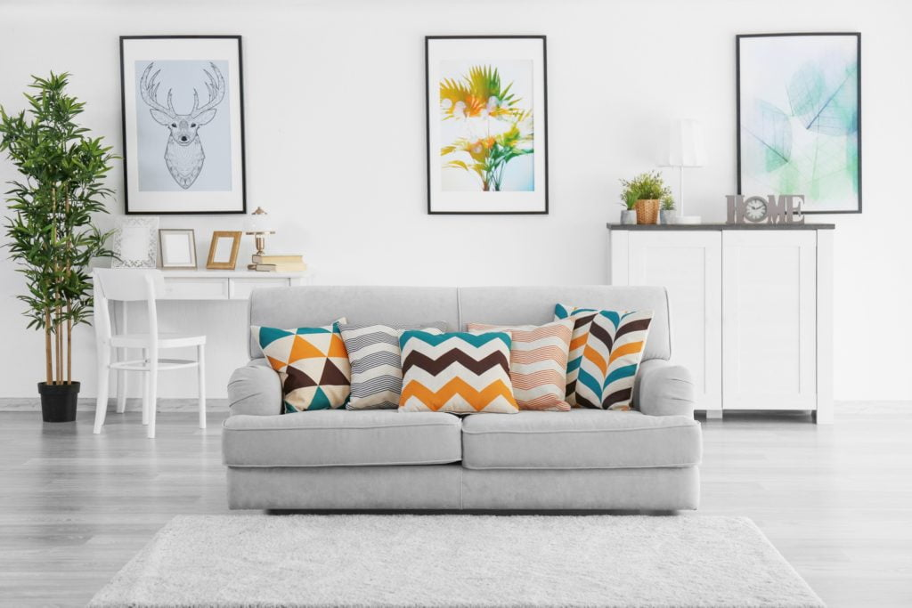 Cozy Gray Den Couch with Bold Decorative Pillow Designs