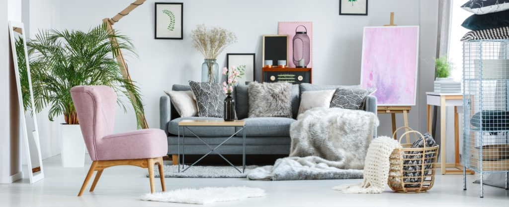 Cozy Pastel Boho Style Living Room with Vintage Pink Velvet Accent Chair