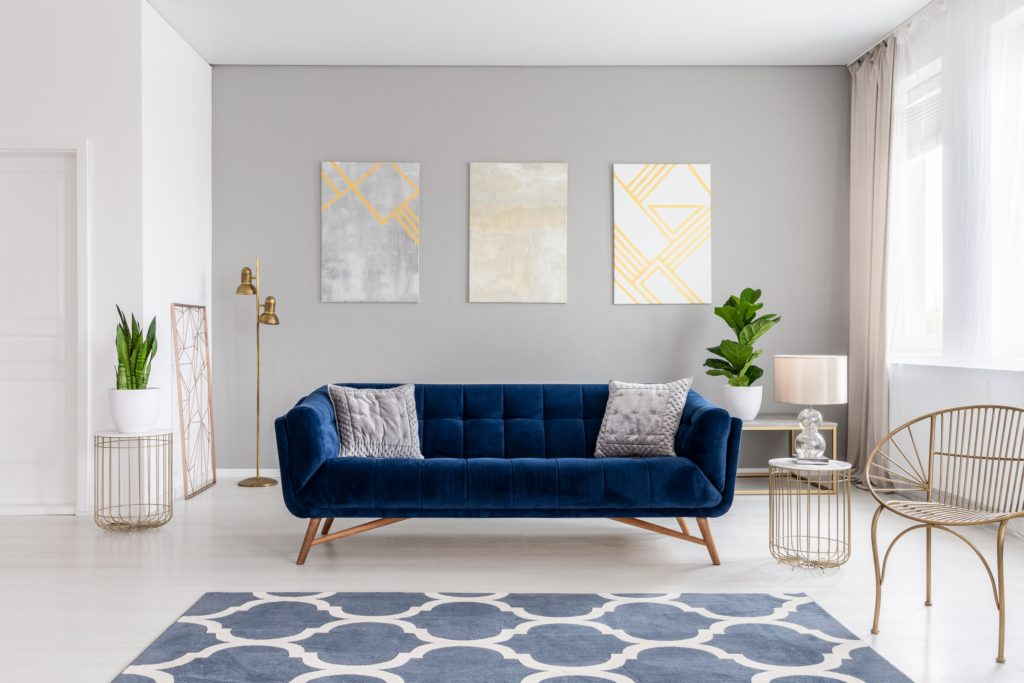 Elegant Navy Living Room Sofa with Stylish Rug and Delicate Diamond Chair