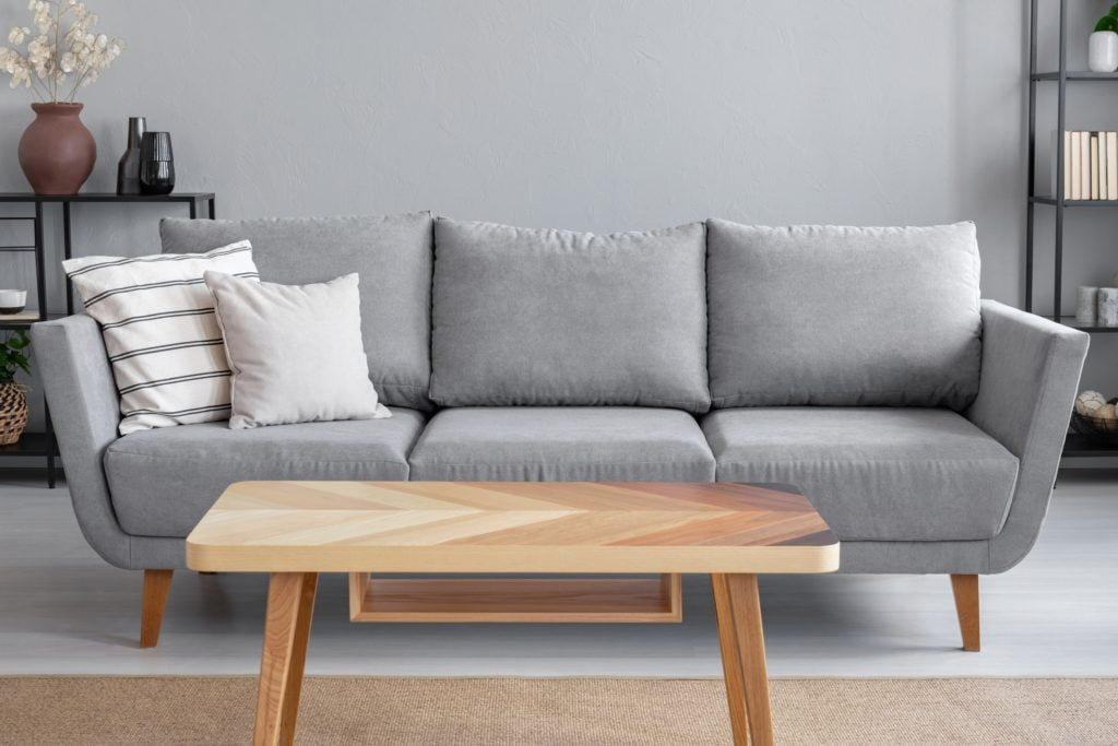 Gray Apartment Couch with Country Cottage Pillows and Decor