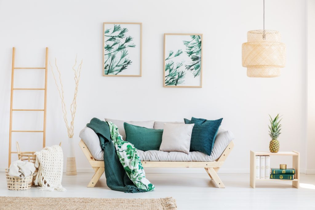 Gray Futon Style Settee Enhanced by Stunning Green Pillows and Decor