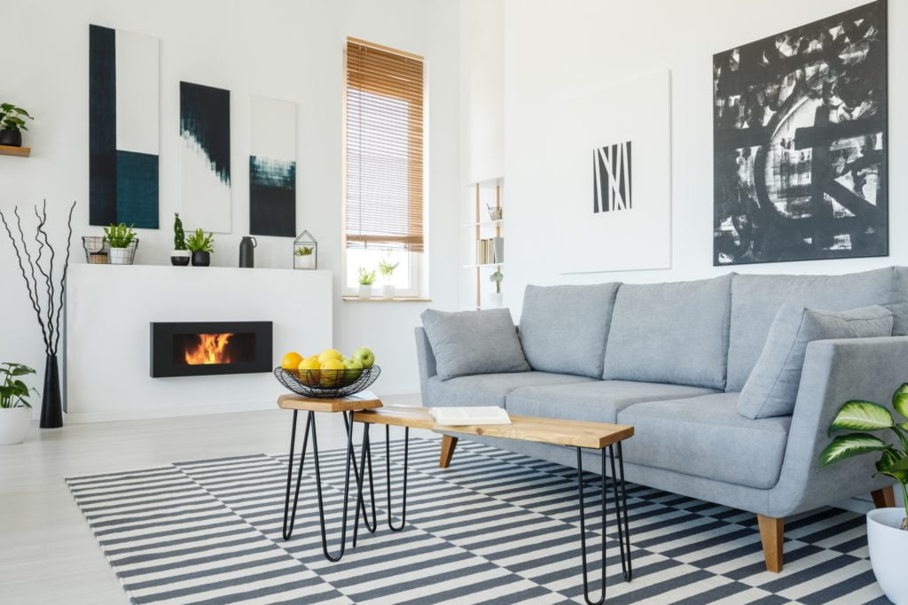 Gray Living Room Sofa and Pillows with Stunning Artwork Accents