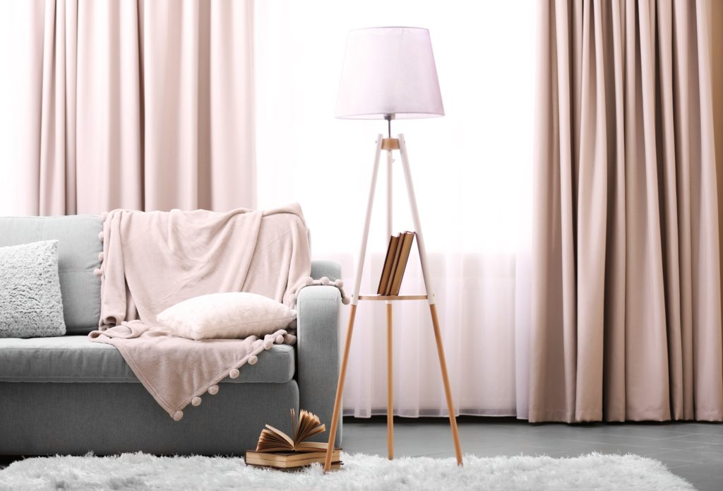 Gray Sofa with Pink Pillow Throw and Surrounding Decor