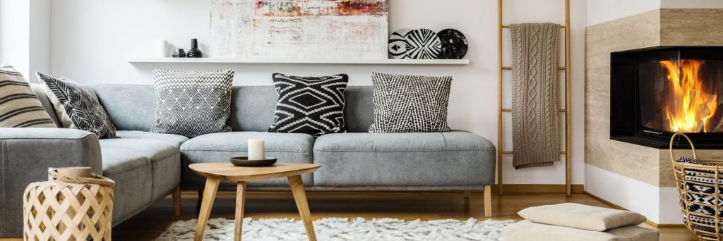 Large Gray Sectional Couch with Stylish Decor and Fireplace