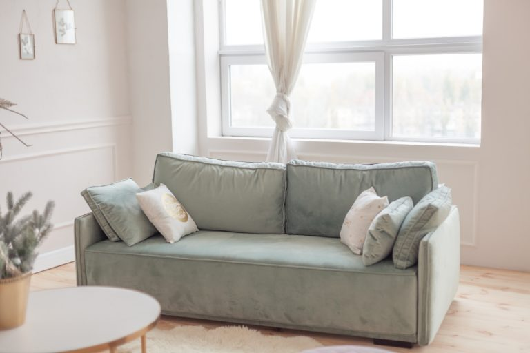 Large Velvet Pale Pistachio Green Sofa Boasting a Classic Design Appears Regal Luxurious with Mix of Accent Pillows
