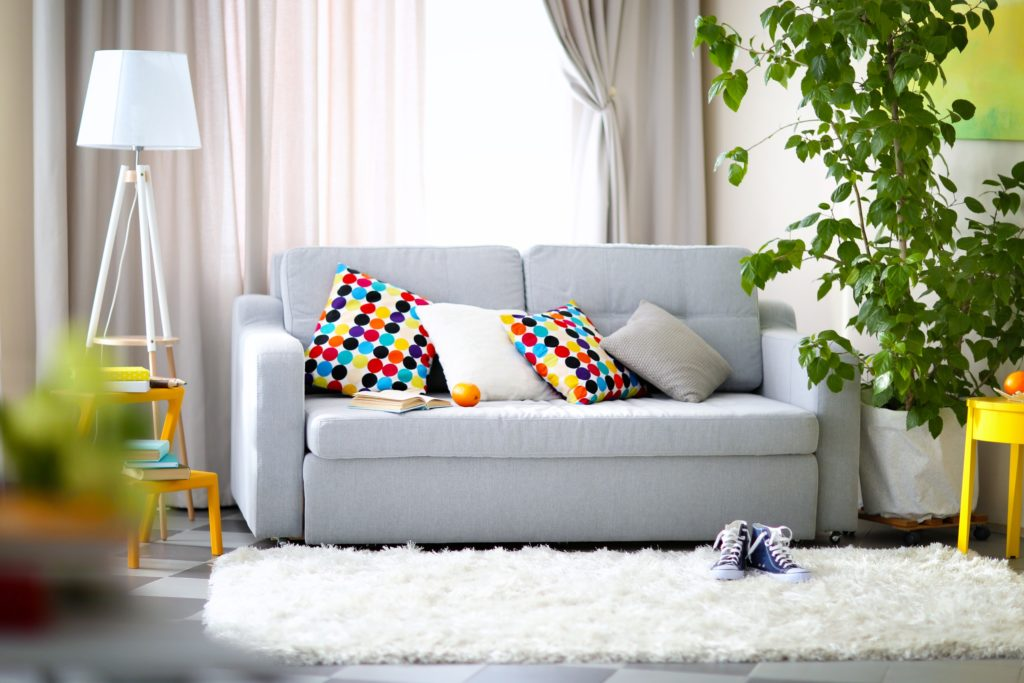 Light Gray Couch with Multi Colored Throw Pillow Accents